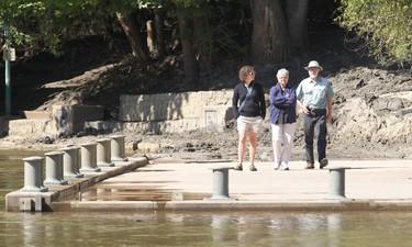 People walk along the Forks Riverwalk in Winnipeg Monday September 05, 2011. The Riverwalk has been partially re-opened following flooding this summer. BRIAN DONOGH/WINNIPEG SUN/QMI AGENCY