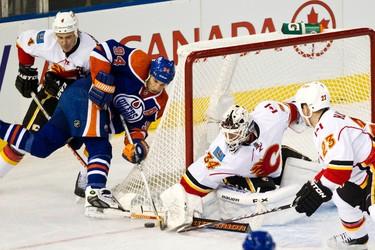Edmonton's Ryan Smyth tries a wraparound on Calgary's Miikka Kiprusoff but fails to score during the first period of the Edmonton Oilers NHL hockey game against the Calgary Flames at Rexall Place in Edmonton on Saturday, January 21, 2012. CODIE MCLACHLAN/EDMONTON SUN QMI AGENCY