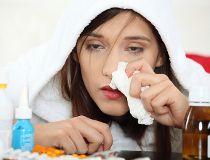 Sick young woman in bathrobe