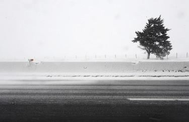 Snow covers a highway near Candela, on Februery 7, 2012. AFP PHOTO / MARIO LAPORTA