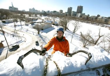 Winnipegger Ian Givens reaches the top of the ice climbing tower of Le Club d'escalade de Saint-Boniface on Sun., Feb. 5, 2012. JASON HALSTEAD/ QMI AGENCY