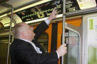 Mayor Rob Ford uses a train map to explain the new subway line he wants, Feb. 8, 2012. (Joe Warmington/Toronto Sun)