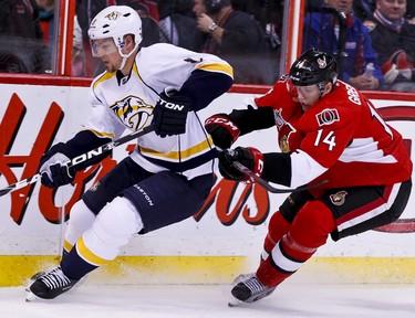 Ottawa Senators Colin Greening pursues Nashville Predators Kevin Klein in first period NHL hockey action at Scotiabank Place in Ottawa, Ontario. Thursday February 9,2012. (ERROL MCGIHON/THE OTTAWA SUN/QMI AGENCY).