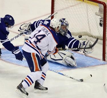 Oilers' Jordan Eberle gets one past Reimer in the first. MICHAEL PEAKE/TORONTO SUN