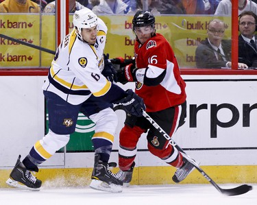 Ottawa Senators Bobby Butler checks Nashville Predators Shea Weber in first period NHL hockey action at Scotiabank Place in Ottawa, Ontario. Thursday February 9,2012. (ERROL MCGIHON/THE OTTAWA SUN/QMI AGENCY).