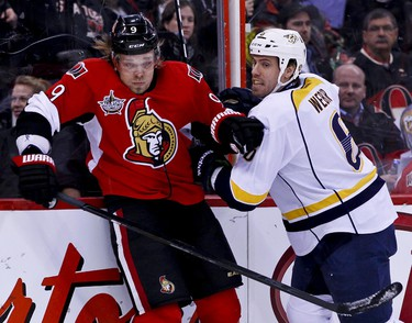 Ottawa Senators Milan Michalek gets checked into the end boards by Nashville Predators Shea Weber in first period NHL hockey action at Scotiabank Place in Ottawa, Ontario. Thursday February 9,2012. (ERROL MCGIHON/THE OTTAWA SUN/QMI AGENCY).