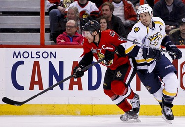 Ottawa Senators Daniel Alfredsson battles with Nashville Predators Shea Weber in third period NHL hockey action at Scotiabank Place in Ottawa, Ontario. Thursday February 9,2012. (ERROL MCGIHON/THE OTTAWA SUN/QMI AGENCY).