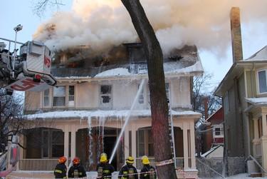 A fire broke out at at 106 Ethelbert Street around 4 a.m. Friday, March 9, 2012. (TESSA VANDERHART/Winnipeg Sun)