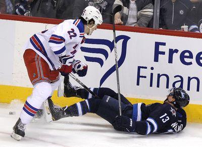 New York Rangers centre Brian Boyle knocks down Winnipeg Jets centre Kyle Wellwood during NHL action on Wed., March 28, 2012 at the MTS Centre in Winnipeg. JASON HALSTEAD/WINNIPEG SUN QMI AGENCY