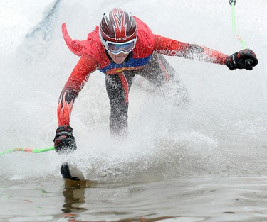 Superman Ryan Danderfer goes crashing into the water during the Nitehawk Recreation Area's annual Slush Cup event Nitehawk's ski hill south of Grande Prairie, Alberta on April 1, 2012. IVAN DANIELEWICZ/QMI AGENCY