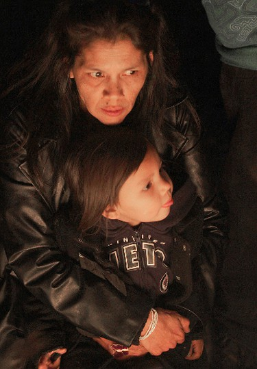 Dolly Felix, aunt of murder victim Jonathen Felix, hugs her niece Sobriety during a vigil in Winnipeg Monday April 2, 2012. Felix was shot to death Saturday, March 31. (BRIAN DONOGH/Winnipeg Sun)