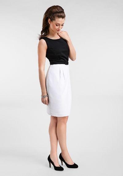 A sleek black and white shift dress ($89.99, Jacob, Jacob.ca) mirrors Middleton's sleek style. (Supplied)