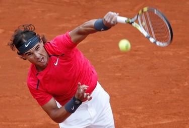 Rafael Nadal of Spain serves to Juan Monaco of Argentina during the French Open tennis tournament at the Roland Garros stadium in Paris June 4, 2012. (REUTERS/Francois Lenoir)