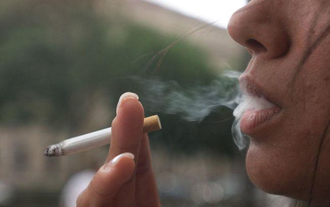 Woman smoking a cigarette - smoking