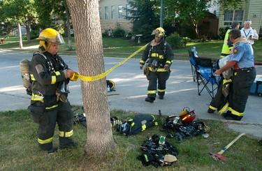 Fire crews battle a blaze at a 58 Birchbark Bay home in Winnipeg, July 8, 2012. (COURTESY OF STAN MILOSEVIC)