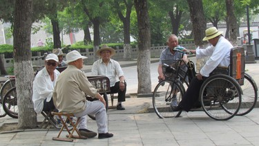 Local men outside entrance to Confucius temple grounds, Qufu, China. IAN ROBERTSON/TORONTO SUN