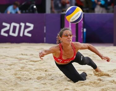 Women's beach volleyball pool play: Annie Martin and Marie-Andree Lessard lost 2-1 to Ekaterina Khomyakova and Evgeniya Ukolova of Russia REUTERS/Lucy Nicholson