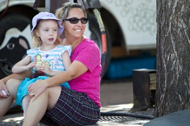 Kelly Palframan took her daughter Josie, 5, to see her first Fringe festival on Sunday. They watched Nick Nickolas' Tennis Ball Magic show during the Edmonton International Fringe Theatre Festival held in Edmonton, Alberta on Aug. 19, 2012. The festival continues until Aug. 26. IAN KUCERAK/EDMONTON SUN/QMI AGENCY
