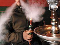 Man smoking with a hookah