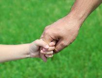 hands holding child dad