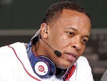 Recording artist Dr. Dre wears a pair of Beats headphones