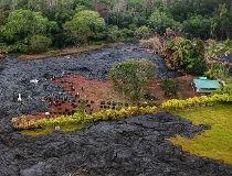 The lava flow from Mt. Kilauea  swirls past a graveyard near the village of Pahoa, Hawaii