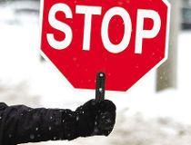 Crossing guard stop sign