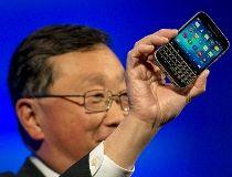 BlackBerry CEO John Chen holds a BlackBerry Classic