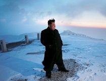 North Korean leader Kim Jong Un views the dawn from the summit of Mt Paektu