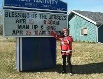Rev. Tara Livingston blessing Flames jerseys