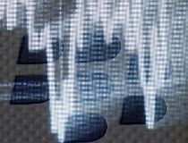 Illuminated stock graph is seen on a BlackBerry logo on a BlackBerry