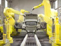Robot kills auto plant worker: report