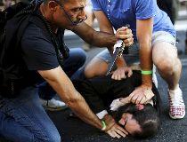 People disarm an Orthodox Jewish assailant