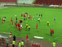 Players for Israeli side Ashdod flee CSKA Sofia supporters.