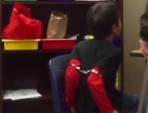 handcuffed child