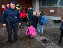 Children pass a police officer