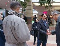 Winnipeg Centre MP Robert-Falcon Ouellette shakes hands with elder Joseph Meconse, Feb. 5, 2016.