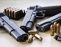 Pistols and bullets gun filer GETTY