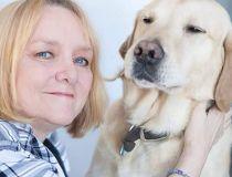 Joy Tomkinson with her assistance dog, Joel.