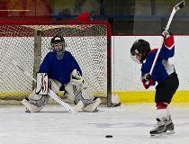 Kid takes a shot on net - hockey