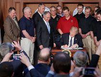 U.S. President Donald Trump signs executive order