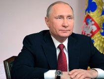 Russian President Vladimir Putin listens during a live video link with Russian Arctic natural gas port Sabetta, in Arkhangelsk, Russia, Thursday, March 30, 2017. (Alexei Druzhinin/Sputnik, Kremlin Pool Photo via AP)