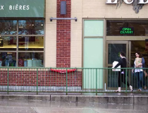Shoppers leave LCBO on Wellington Street West