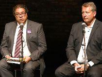 Calgary Mayor Naheed Nenshi between candidates David Lapp and Bill Smith